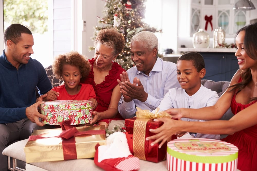 family opening presents on Christmas